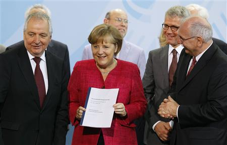 German Chancellor Merkel receives Ethics Commission for a Secure Energy Supply report from former German Environment Minister Toepfer and Kl