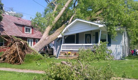 A home off Columbia in Battle Creek, Michigan sits after being impacted by a large tree following severe storms Sunday May 29th, 2011.