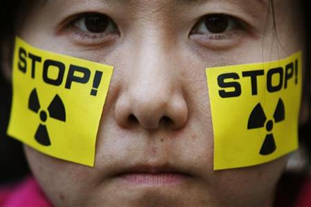 An anti-nuclear protester takes part in a rally in front of Tokyo Electric Power's headquarters in Tokyo