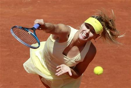 Sharapova of Russia serves to Petkovic of Germany during their quarter-final match at the French Open tennis tournament at the Roland Garros