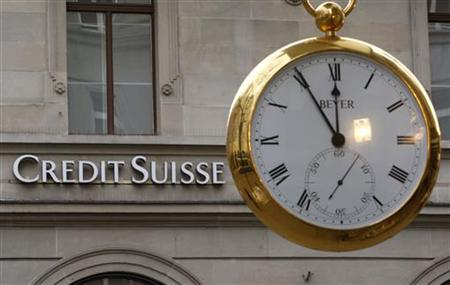 A giant watch displays the time in front of the logo of Swiss Credit Suisse bank at the Bahnhofstrasse in Zurich