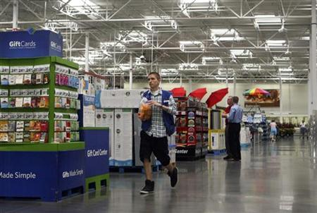 An employee walks down the new center aisle at a remodelled Sam's Club in Rogers, Arkansas