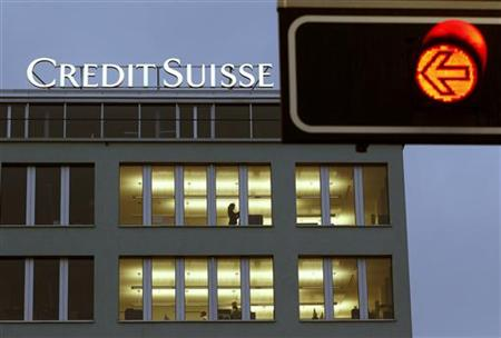 A traffic light is seen in front of an office building of Swiss bank Credit Suisse in Zurich