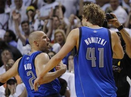 Mavericks' Kidd celebrates with teammate Nowitzki after a basket against the Heat during Game 2 of the NBA Finals basketball series in Miami