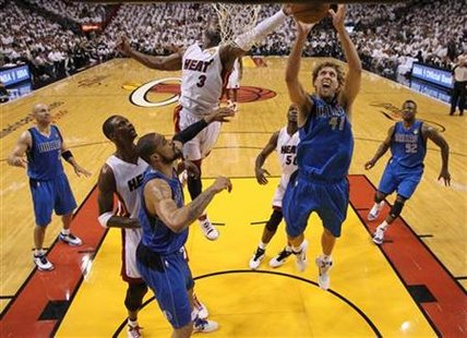 Dallas Mavericks' Nowitzki of Germany fights for a rebound with Miami Heat's Wade during the second half in Game 2 of the NBA Finals basketb
