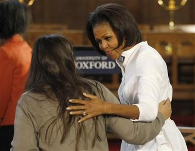U.S. first lady Obama talks with a student from the Elizabeth Garrett Anderson School at Oxford University in Oxford