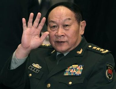 China's Defence Minister Liang waves during the IISS Asia Security Summit in Singapore