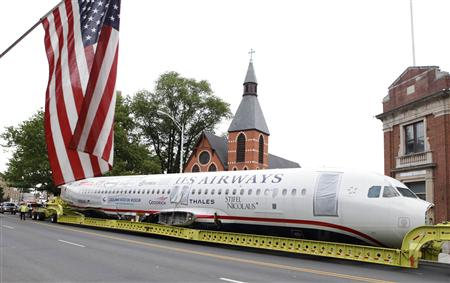 "U.S. Airways flight 1549 also known as the ""Miracle on the Hudson"" is hauled on a truck through the streets in Elizabeth, New Jersey"