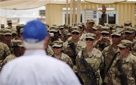 A soldier raises his hand to ask a question to U.S. Secretary of Defense Robert Gates at FOB Walton in Afghanistan