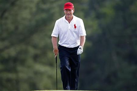Tom Watson of the U.S. walks onto the 18th green during first round play in 2011 Masters golf tournament in Augusta