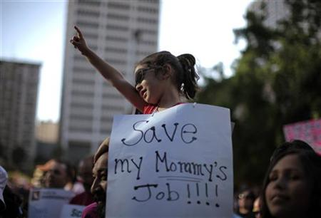 A girl protests about her mother being laid off during a rally against education budget cuts in Los Angeles