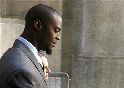 NFL player Plaxico Burress and lawyer Benjamin Brafman depart Manhattan State Supreme Court in New York