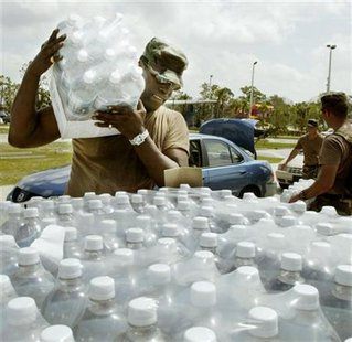 Natonal Guard hands out water in Sebastian to Hurricane victims.