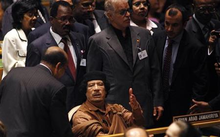 Libyan leader Muammar Gaddafi waits at his seat to be escorted to the podium before addressing the 64th United Nations General Assembly in N