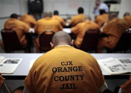 Inmates sit in a classroom at the Orange County jail in Santa Ana