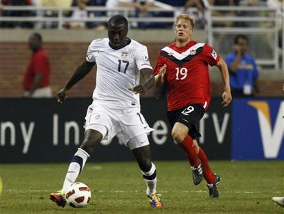 Jozy Atlidore of the U.S controls the ball in front of Canada's Marcel Dejong during their CONCACAF Gold Cup soccer match in Detroit, Michig