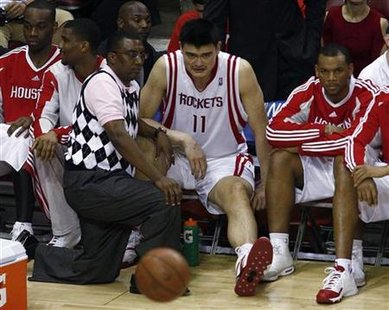 Houston Rockets center Yao Ming sits on the bench in the fourth quarter during their NBA playoff basketball game against the Lakers in Houst