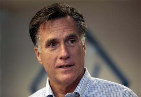 U.S. Republican presidential candidate Mitt Romney talks to supporters during a visit to Bizdom U in Detroit, Michigan