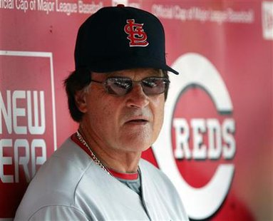 St. Louis Cardinals manager Tony La Russa watches his team's play from the dugout during the first inning of play against the Cincinnati Red