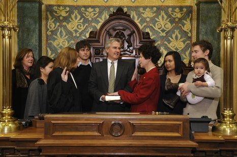 State Representative Amanda Price (R-Park Twp.) is sworn in to office by Michigan Supreme Court Justice Mary Beth Kelly (L) while Price's family looks on. (photo courtesy Michigan House Republicans)