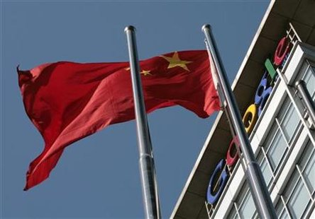 A Chinese national flag flies in front of Google China's headquarters in Beijing