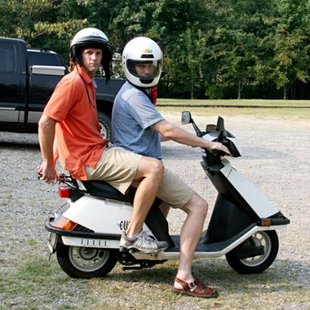 people riding a Moped