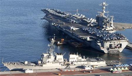 The U.S. nuclear-powered aircraft carrier USS George Washington and the Arleigh Burke-class guided-missile destroyer USS McCampbell anchor a