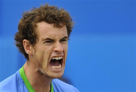 Murray of Britain reacts after winning the second set during his singles final match against Tsonga of France at the Queen's Club Championsh