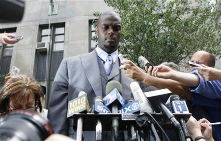 Former NFL player Plaxico Burress gives a statement outside of Manhattan criminal court after testifying before a grand jury in New York