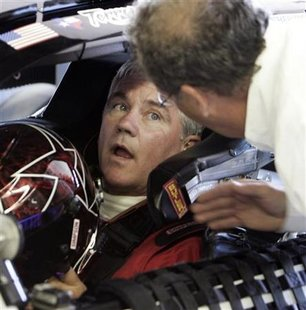 NASCAR champion Labonte is given instructions as he test drives Circuit Gilles Villeneuve in Montreal