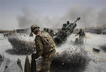 U.S. Army soldiers from the 2nd Platoon, B battery 2-8 field artillery, fire a howitzer artillery piece at Seprwan Ghar forward fire base in