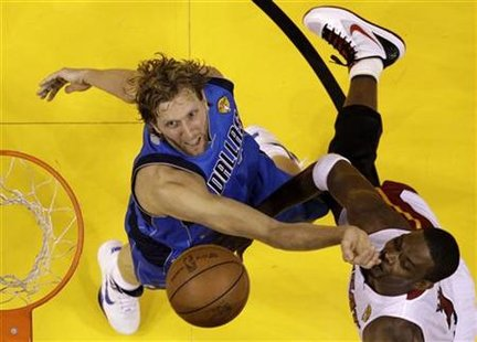 Mavericks power forward Nowitzki stops Heat power forward Bosh from scoring in the second half during Game 6 in Miami