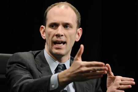 Goolsbee gestures as he addresses speaks during the 2010 meeting of the Wall Street Journal CEO Council in Washington