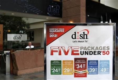 An advertising sign in the lobby of the corporate headquarters of Dish Network shows current packages in the Denver suburb of Englewood