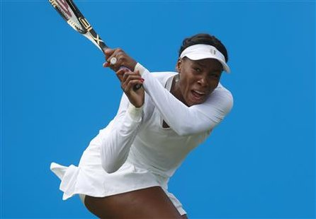 Venus Williams returns a shot from Germany's Andrea Petkovic during the International Women's Open tennis tournament in Eastbourne