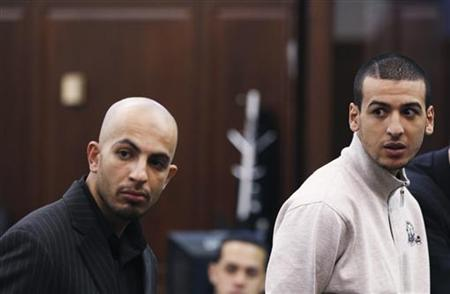 Ahmed Ferhani and Mohammed Mamdouh stand before a judge during their arraignment in Manhattan criminal court in New York