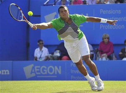 Jo-Wilfried Tsonga of France returns the ball during his International Men's Open tennis tournament match against Denis Istomin of Uzbekista