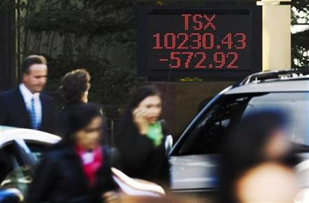 A sign displays TSX information in Toronto