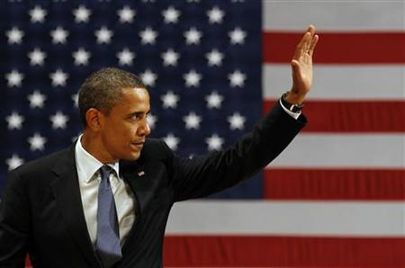 U.S. President Barack Obama waves after he speaks at the Adrienne Arsht Center in Miami