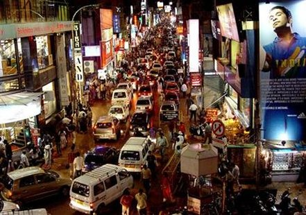 -PHOTO TAKEN 02OCT04- Commuters are seen on a busy commercial street in the southern Indian city of ..