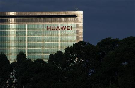 A Huawei plant is lit by a setting sun in the southern Chinese township of Longhau in Guangdong province