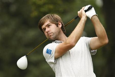 Britain's Rock watches his shot from the third tee in the first round of the 2011 U.S. Open in Maryland