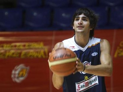 Spain's basketball player Ricky Rubio prepares to shoot during Spain's national team practice session in Madrid, August 12, 2010.