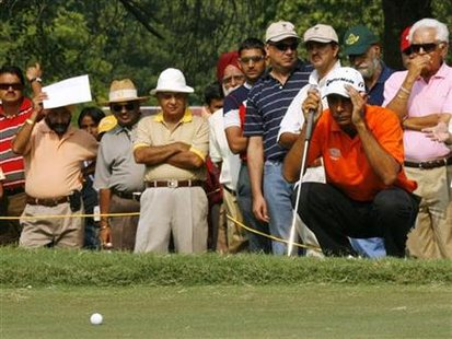 Indian golfer Randhawa watches his ball during the Indian Open Asian Tour event in New Delhi