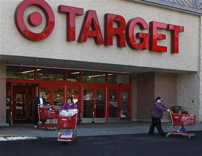 File photo of shoppers exiting a Target store with their purchases in Fairfax