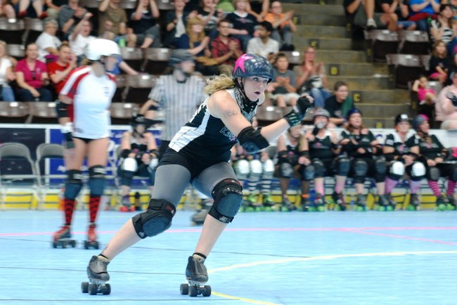 The Killamazoo Derby Darlins take on the Naptown Warning Belles at Wings Stadium 06/18/11.  Photos by Sean Patrick Duross.