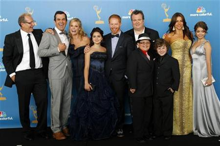 The cast of Modern Family poses backstage at the 62nd annual Primetime Emmy Awards in Los Angeles
