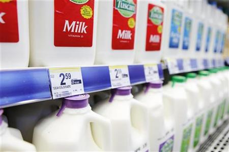 Price labels of half gallons of milk for sale are seen in a store in New York