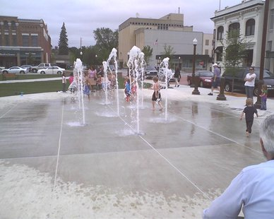 Children play in the new 400 Block fountain donated by Asprius of Wausau, June 20, 2011