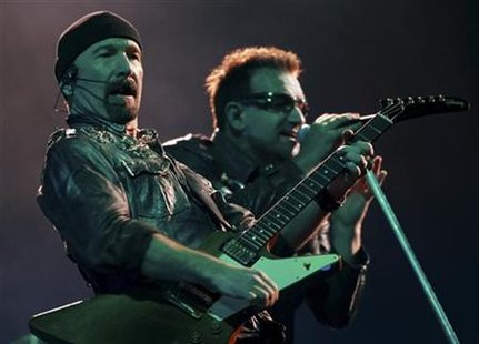 Irish singer Bono and guitarist The Edge perform with his band U2 during their show at Morumbi stadium in Sao Paulo